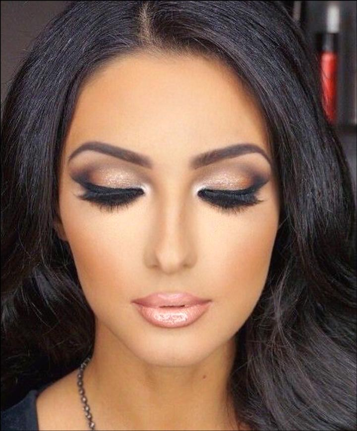 Beautiful girl with perfect eye makeup and lipsticks in black hairs