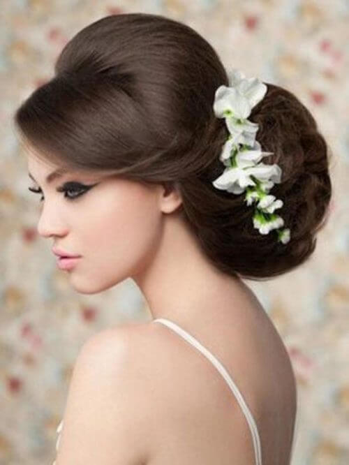 FLOWERY BUN Stylish Puff Hairstyles For Round Face