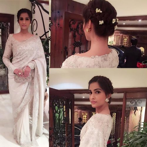 BRAIDED CROWN WITH FLOWERSSonam Kapoor Hairstyles For Your Perfect Look