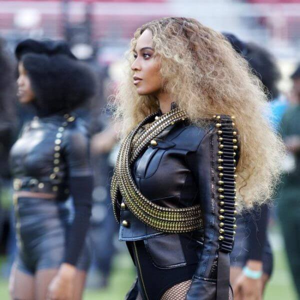 Beyonce's Hairstyles american singer, songwriter texture brushed back curls hairstyles