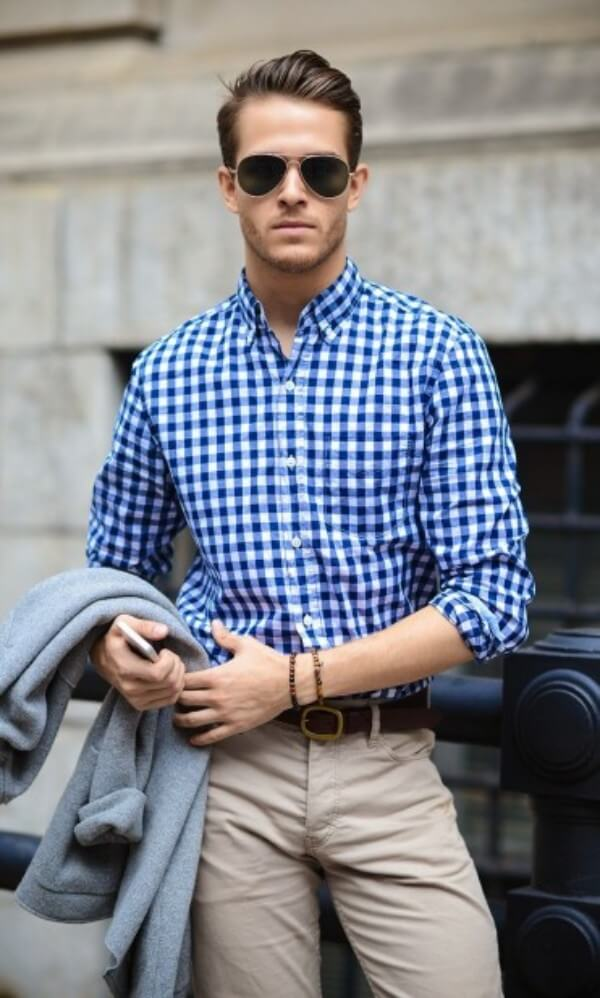 Men's blue checked shirt with beige trousers for office and casual look