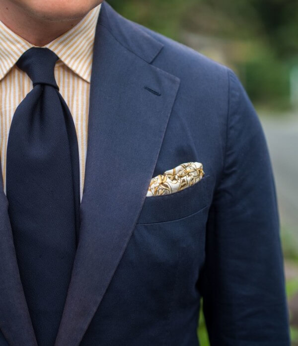 Men's navy blue suit and tie with yellow striped shirt for office look