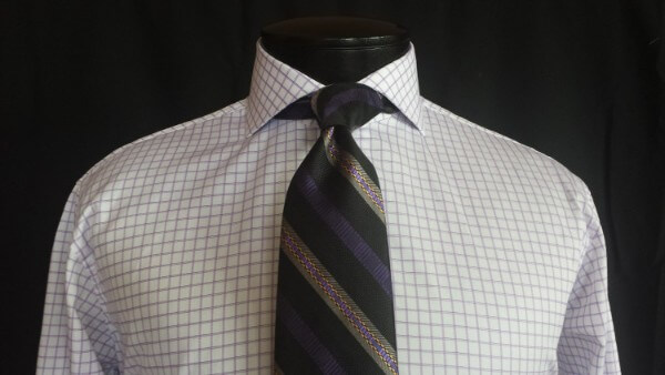 Men's checkered shirt with striped tie for office look