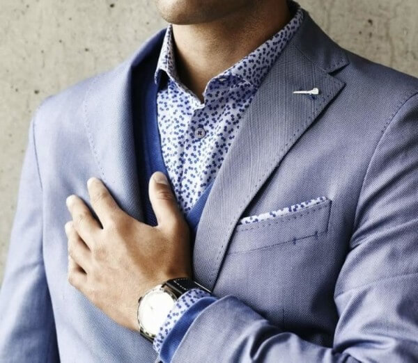 Men's blue suit with polka dot shirt and without a tie for office or any other occasion