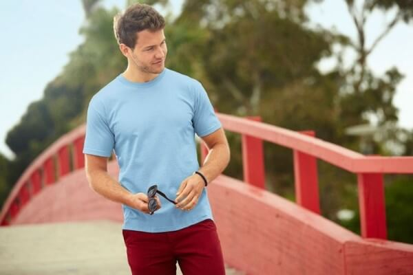 Men's light blue round neck t-shirt with burgundy trousers for casual look