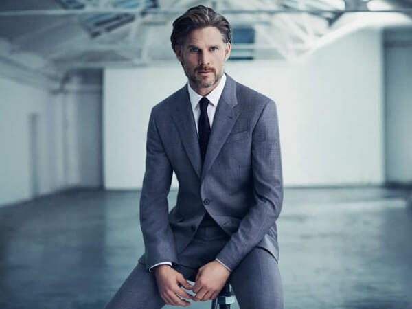 Noah Huntley blue suit set with white shirt and blue tie for office look