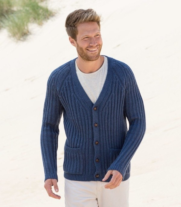 Men's classic knitted blue cardigan with white t-shirt and trousers