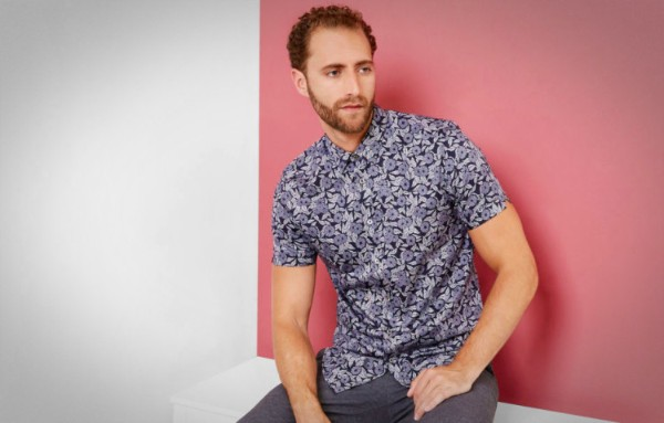 Men's printed shirt with grey trousers for casual look