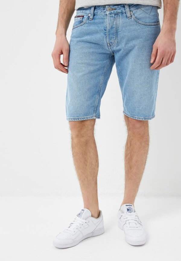 Men's denim bermuda shorts with white shoes for summer or casual look