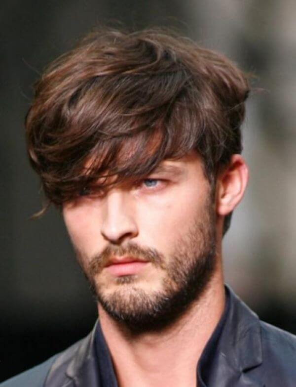 Long fringe men's hairstyle for triangle face