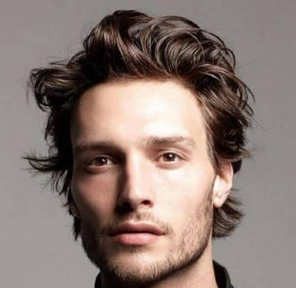 Medium length men's wavy hairstyle for curly hair