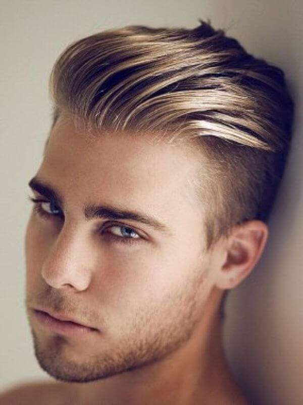 Blonde slick back with flow haircut for men