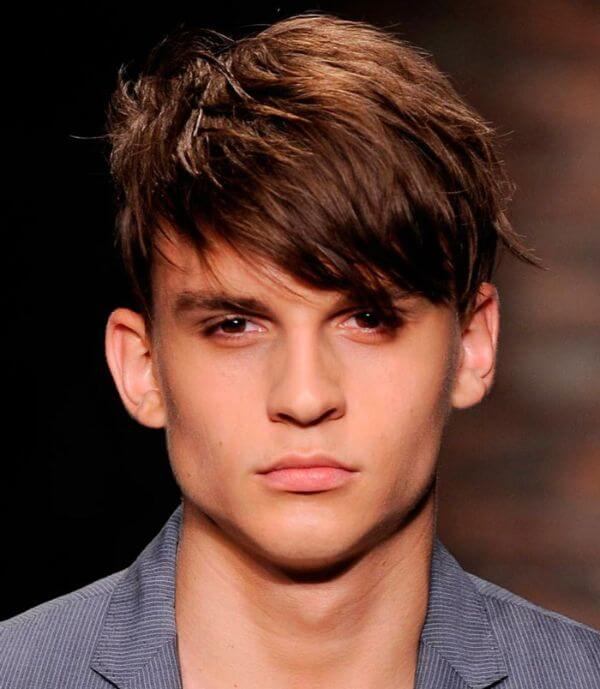 Side swept bangs or low fade long fringe hairstyle for man