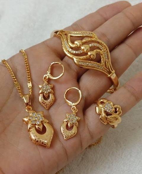 Beautiful spiral designer gold bracelet and ring set New Gold Bracelet And Ring Set Designs