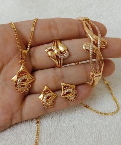 Trendy designer gold bracelet and ring set New Gold Bracelet And Ring Set Designs