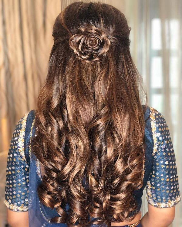 Rose bun Elegant Hairstyles for Long Hair to Suit Your Style