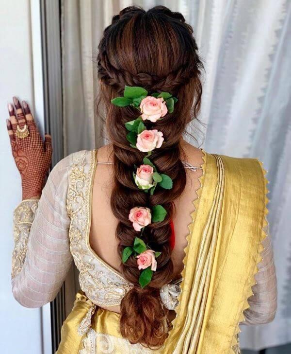 Flower adorned plait