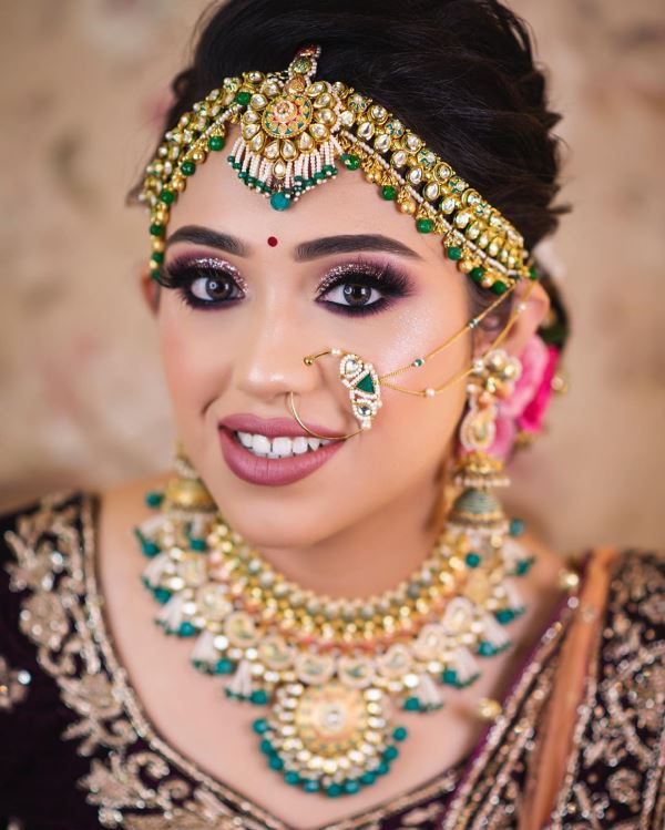 Glittery eyes with brown lips: Indian Bridal Makeup for Traditional Look
