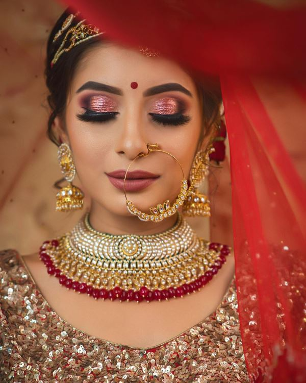 Pink shimmery eyes with brown lips: Indian Bridal Makeup for Traditional Look