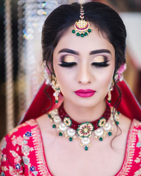 Gold-toned eyes with pink lips: Indian Bridal Makeup for Traditional Look