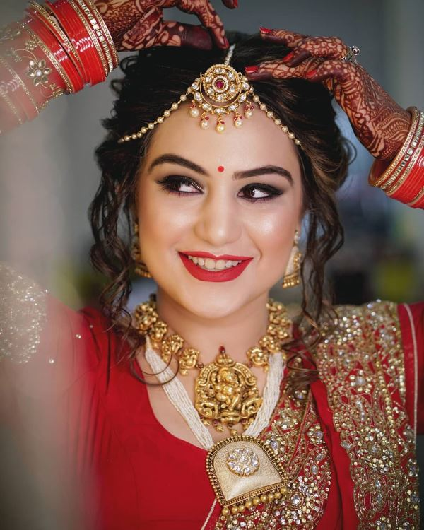 Classic red lips: Indian Bridal Makeup for Traditional Look