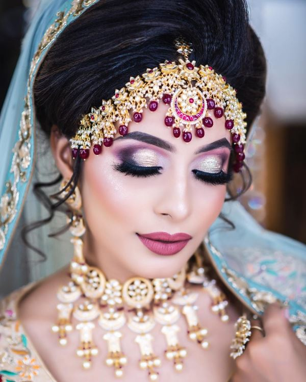 Cut crease eyes with a mauve pout: Indian Bridal Makeup for Traditional Look
