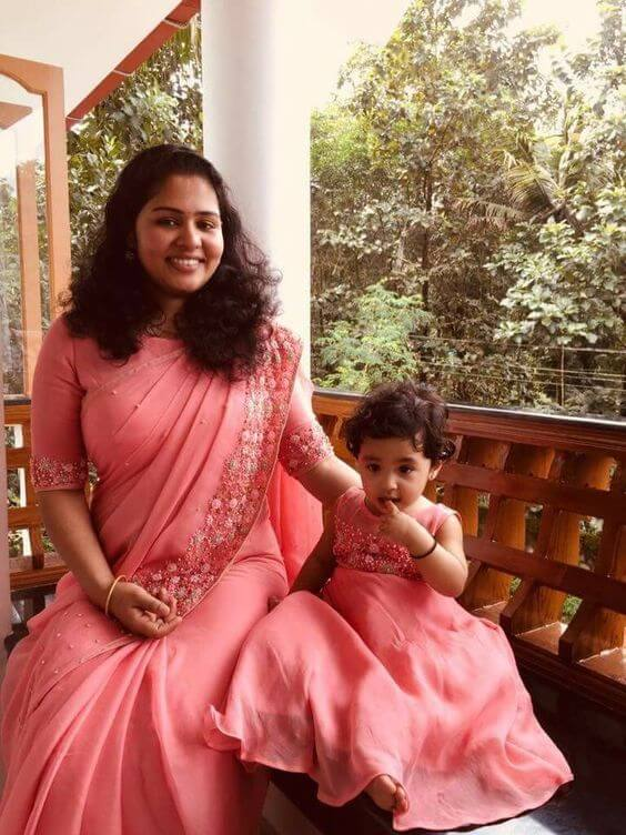 Pink matching outfit for mother and daughter