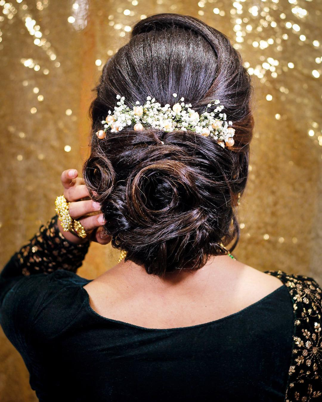 A low bun: Trending Bun Hairstyles for your Wedding Reception