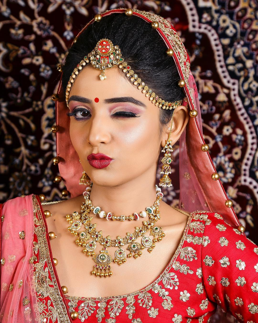 Cut crease eye makeup with a red hot pout: Indian Bridal Makeup Look in Celeb Style