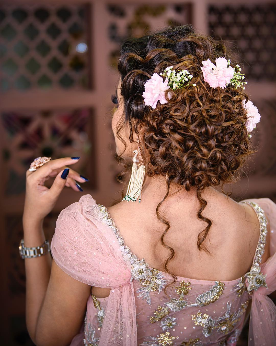 Bun with curls: Trending Bun Hairstyles for your Wedding Reception