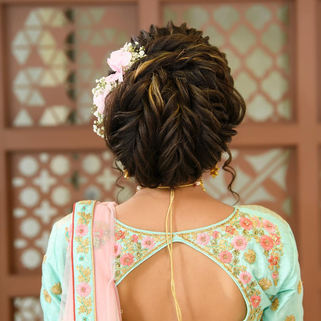 Bun with fishtail braid: Trending Bun Hairstyles for your Wedding Reception