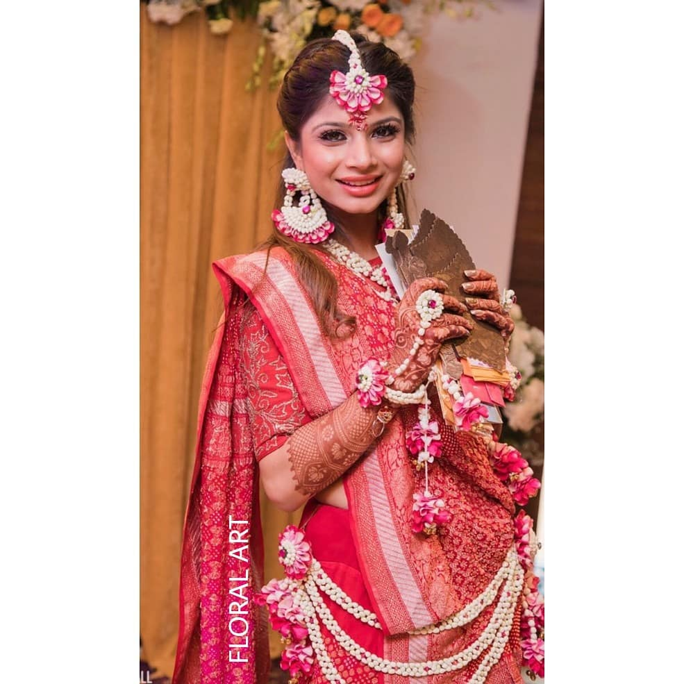 . Charming pink floral jewelry:  Haldi Ceremony Floral Jewellery for Your Wedding