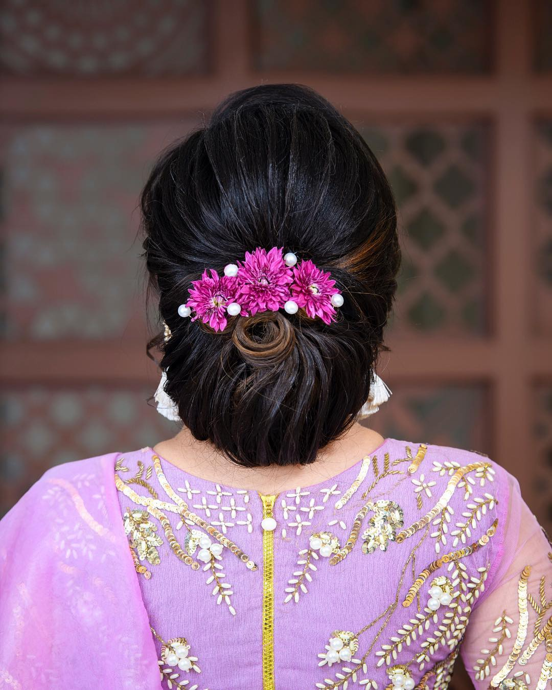 Classic low chignon: Trending Bun Hairstyles for your Wedding Reception