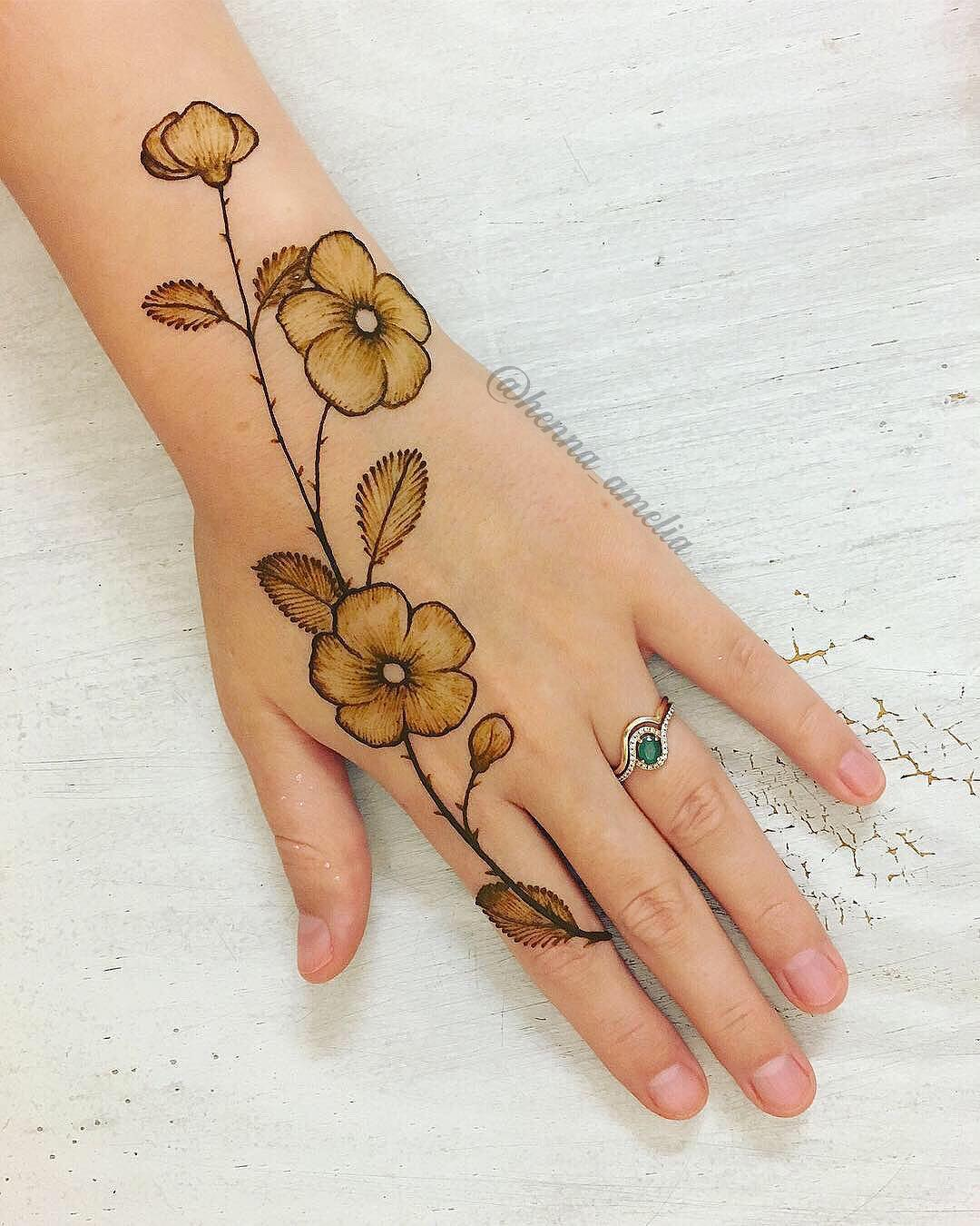 Painted flowers mehndi design  Easy Mehndi Designs Collection for Hand 2020