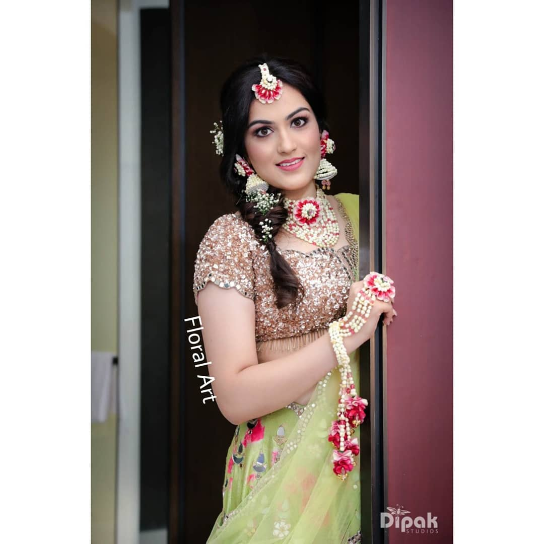 Gorgeous Red and white floral jewellery:  Haldi Ceremony Floral Jewellery for Your Wedding