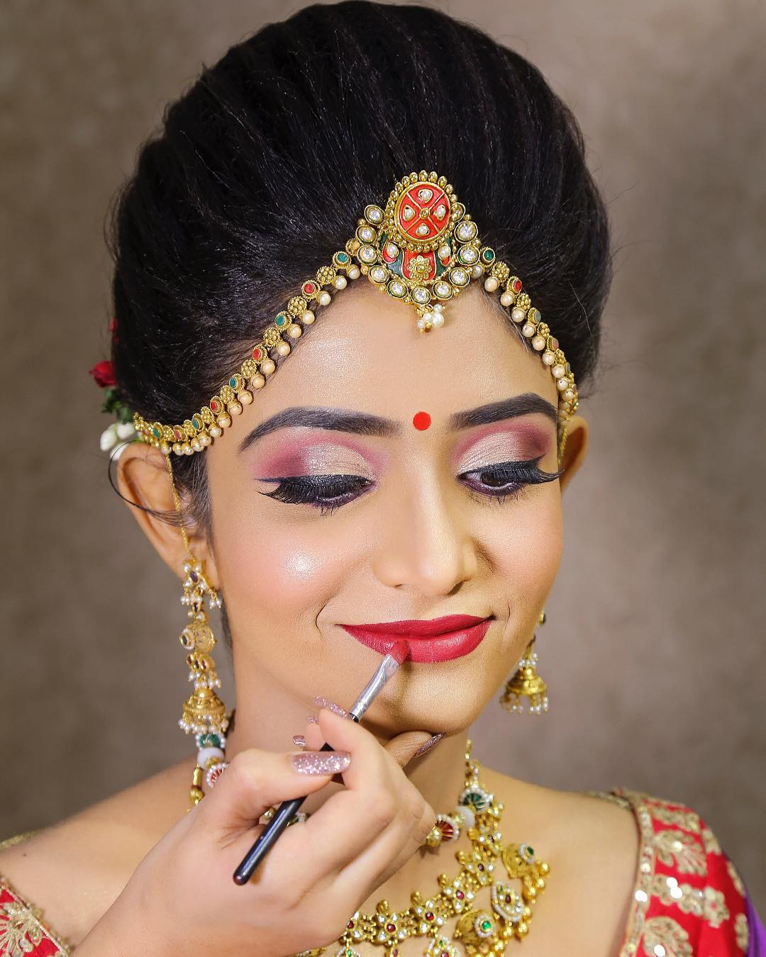 Classic red lips: Indian Bridal Makeup Look in Celeb Style