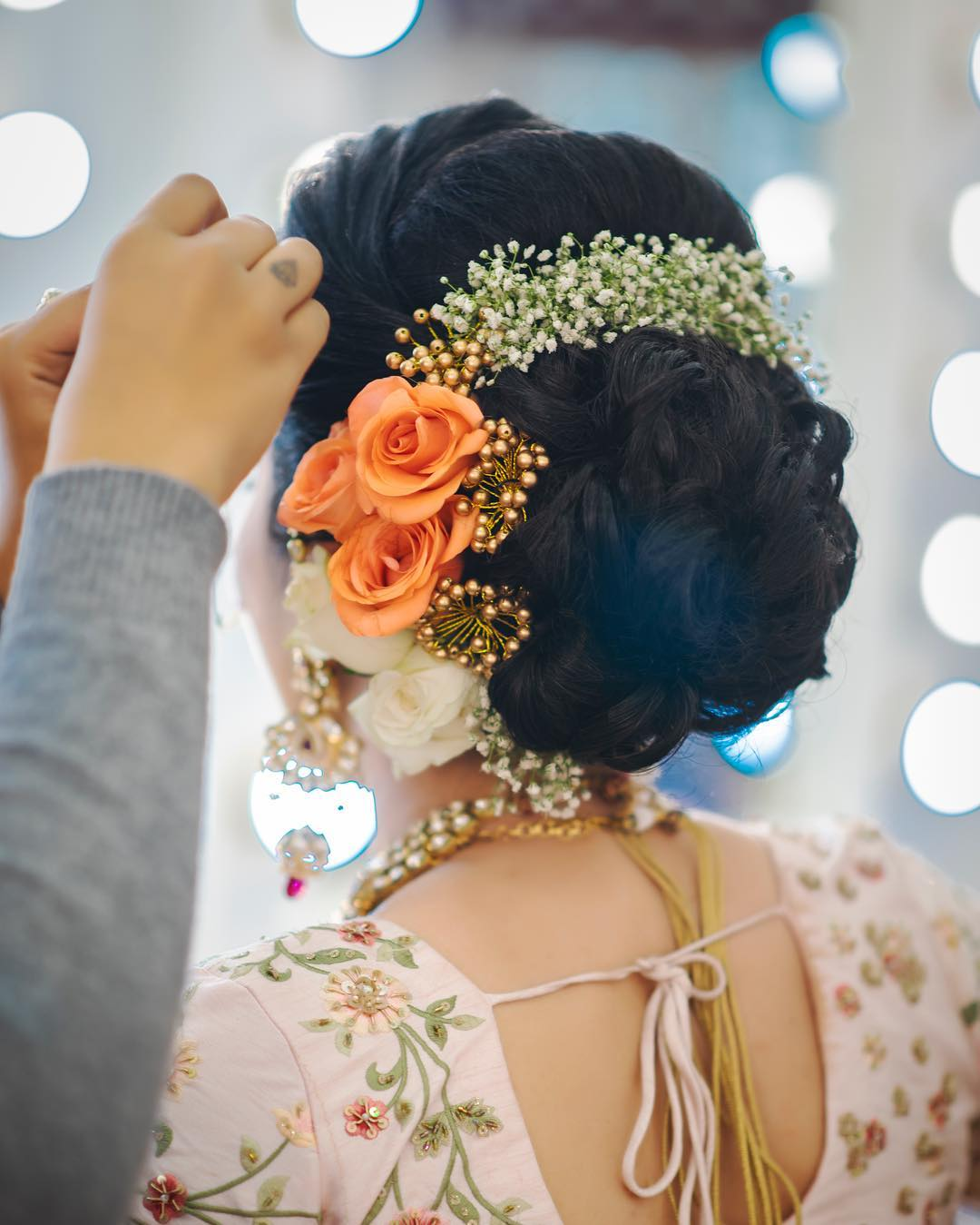 Bright and fresh: Floral Bun Hairstyles for Brides this Wedding Season