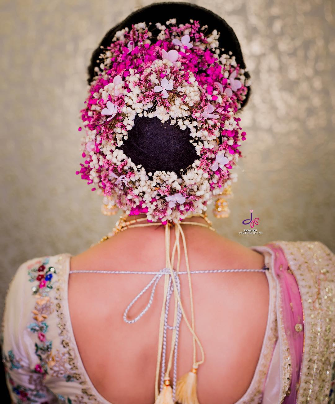 The charm of pink: Bridal Bun Hairstyles with Flower Jewellery