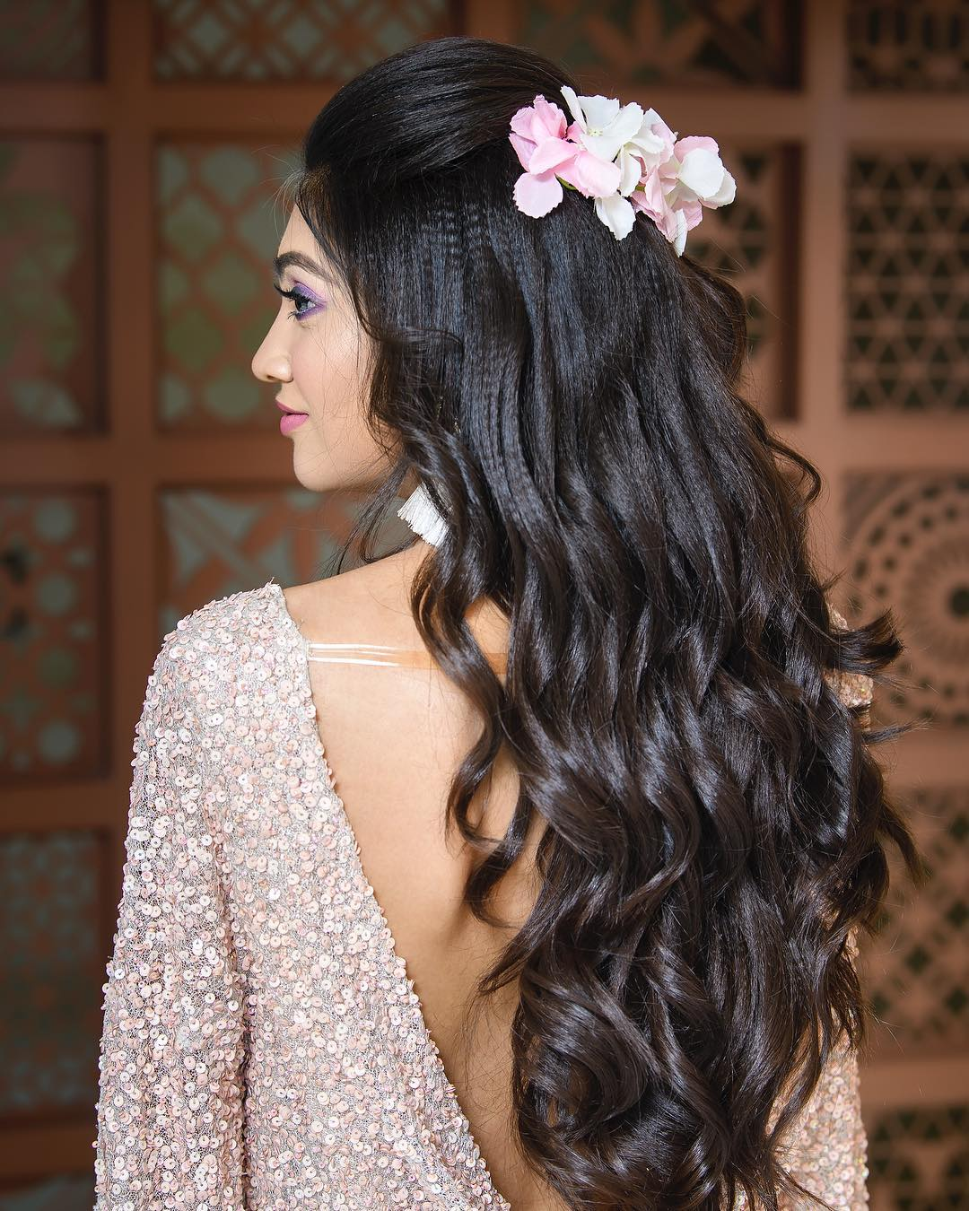 Pink and white flowers: Trending Bun Hairstyles for your Wedding Reception