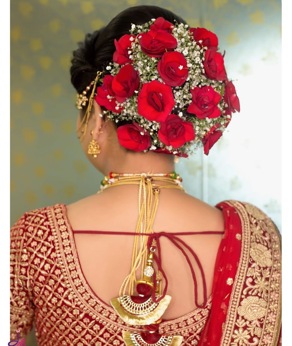 The moment of love: Bridal Bun Hairstyles with Flower Jewellery