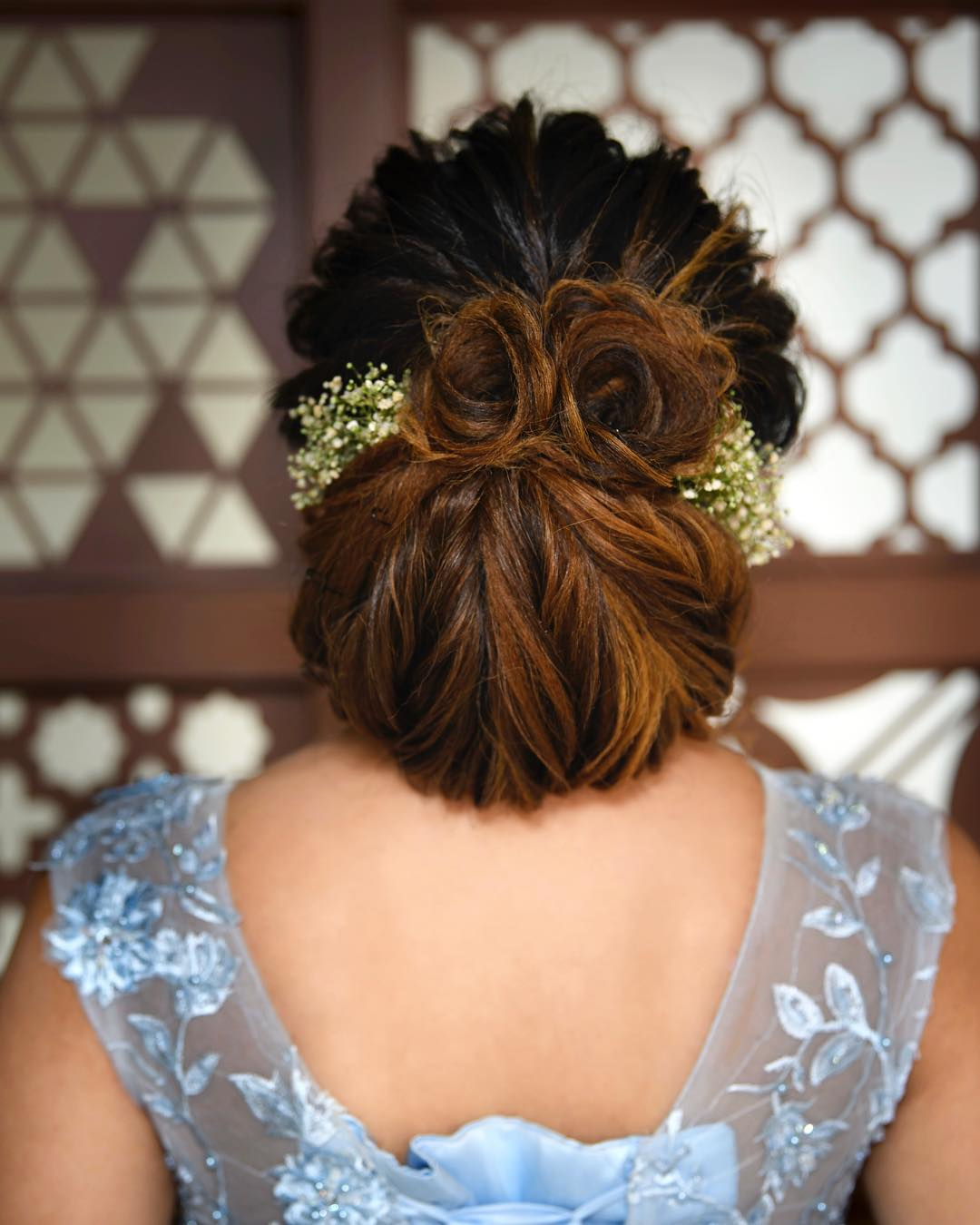 Rolled up bun: Trending Bun Hairstyles for your Wedding Reception