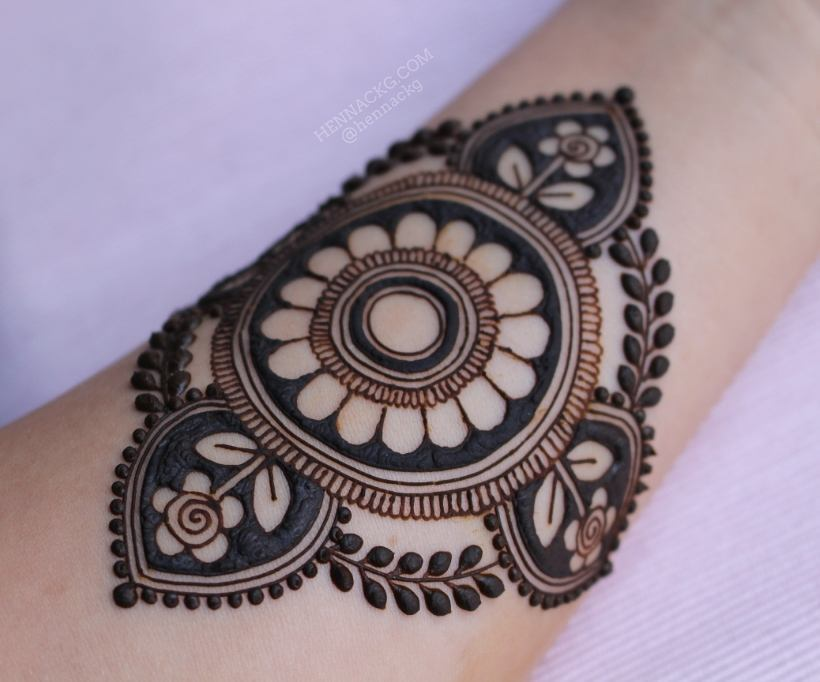 Decorated wrist with Mandala Henna Tattoo Modern Mehndi Designs for Hands By Henna CKG