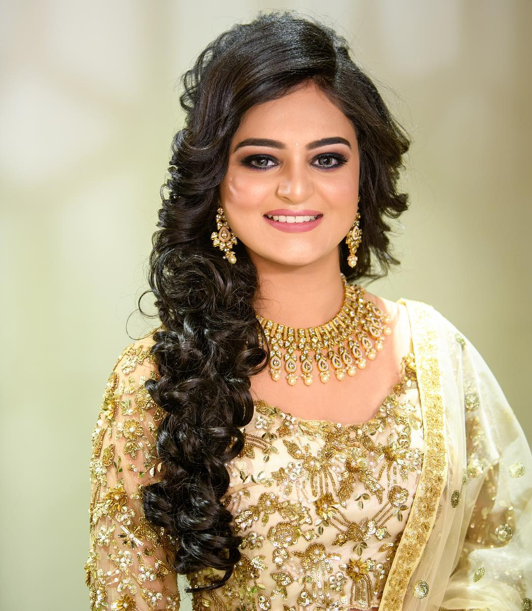 Soft curls: Floral hairstyles for Haldi and Mehendi Ceremonies!a