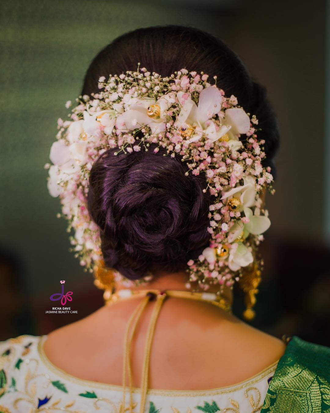 Beauty in White: Bridal Bun Hairstyles with Flower Jewellery