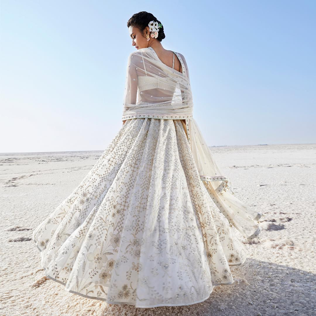 White embroidered lehenga: Silk Saree Designs Inspired from Bollywood Divas