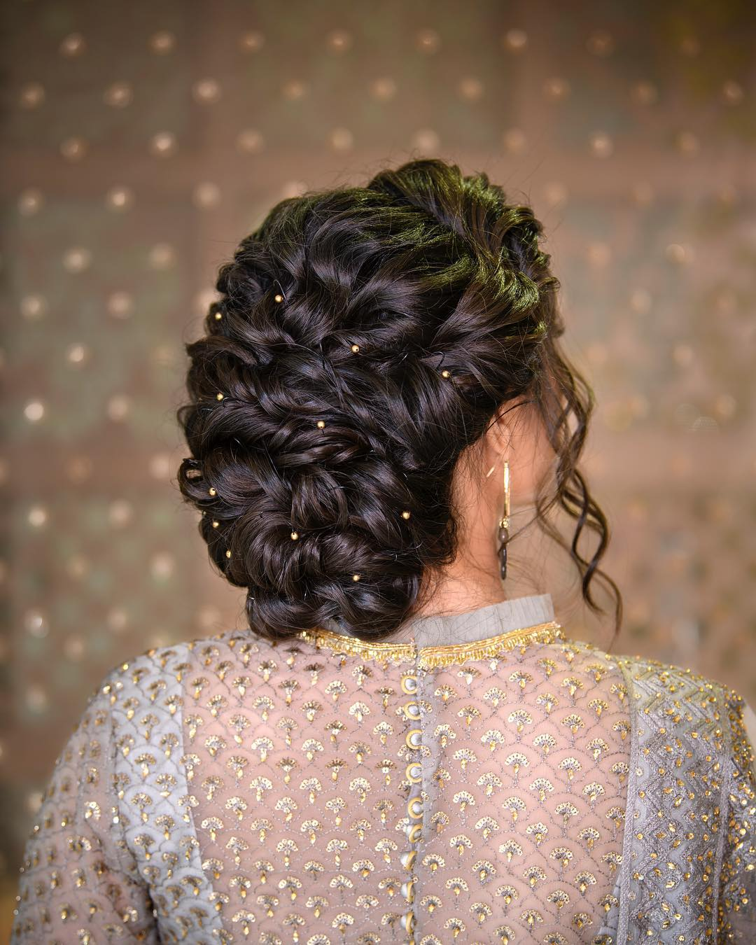 Twisted hair bun: Trending Bun Hairstyles for your Wedding Reception