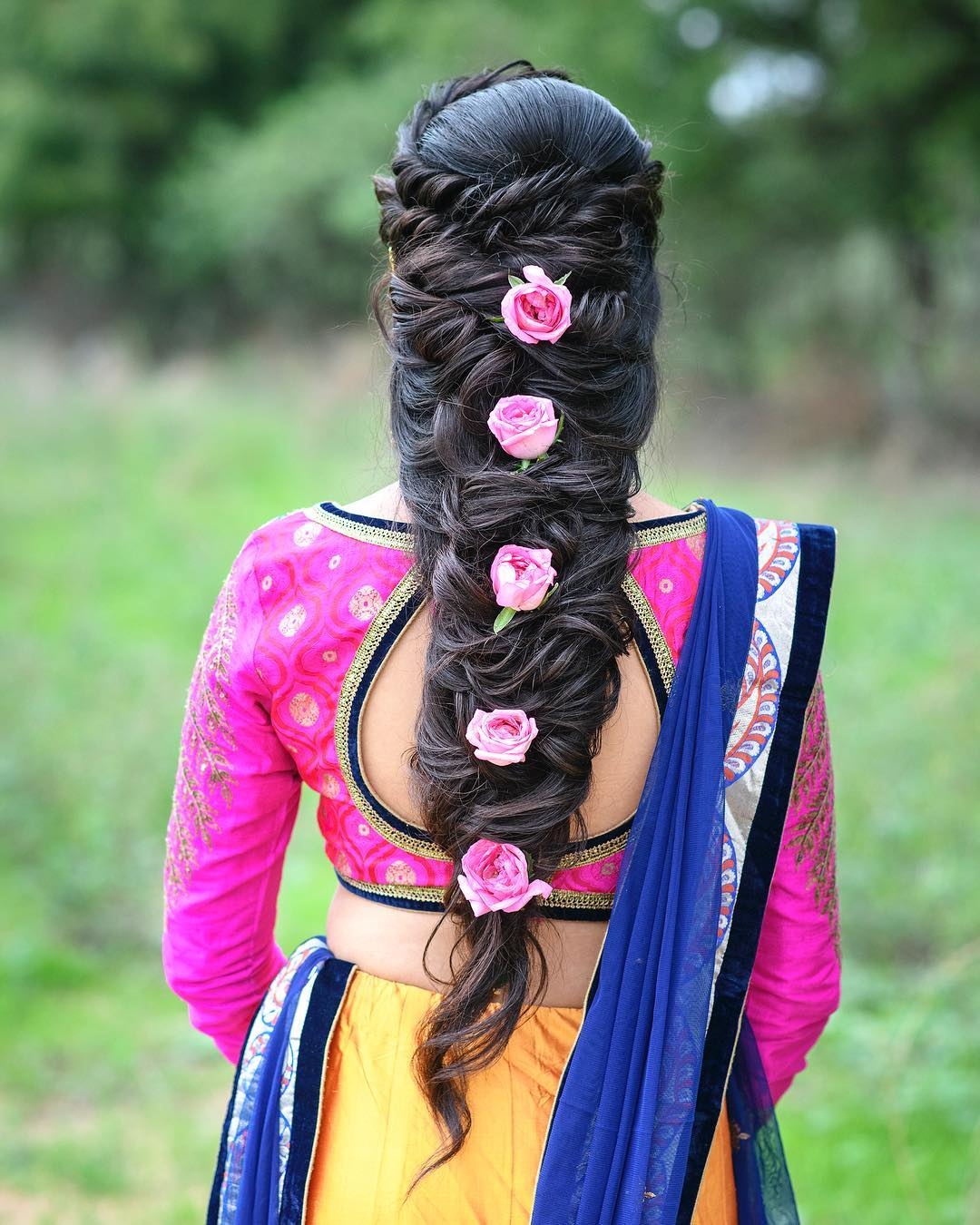 Pink roses: Floral hairstyles for Haldi and Mehendi Ceremonies!a