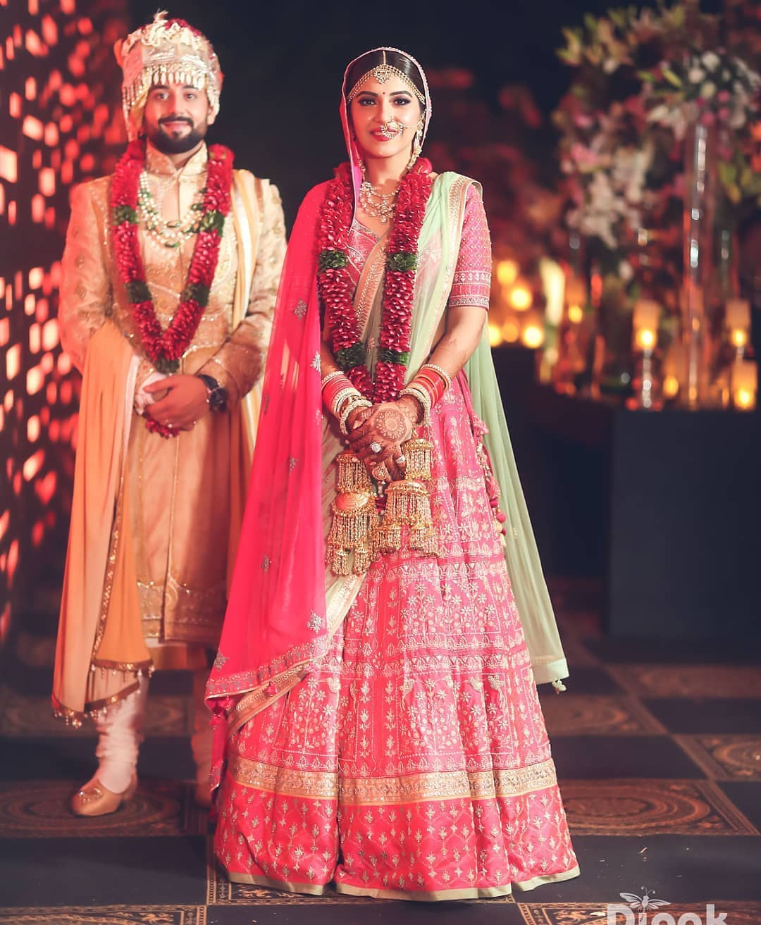 Baby pink and ivory combination: Bride and Groom Wedding Dress Colour Combinations