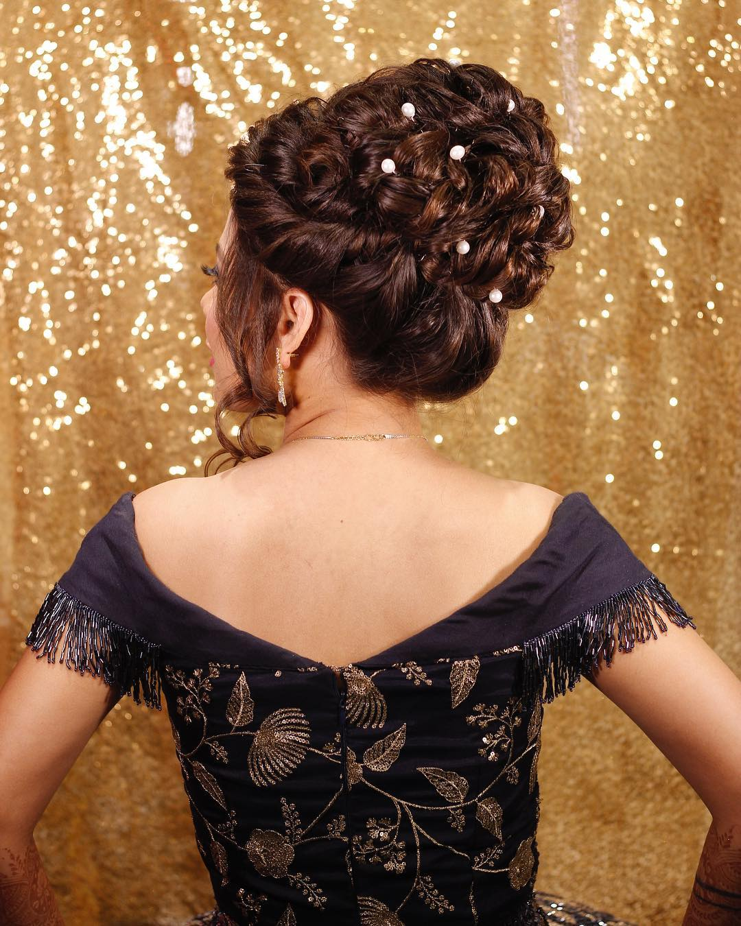Bun with adjacent pearls: Trending Bun Hairstyles for your Wedding Reception