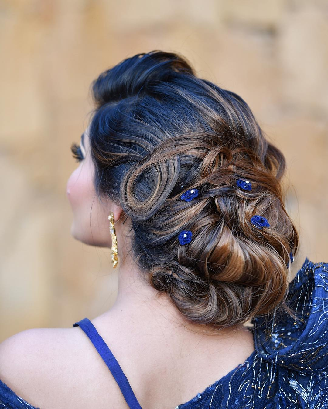 Bun with blue accents: Trending Bun Hairstyles for your Wedding Reception